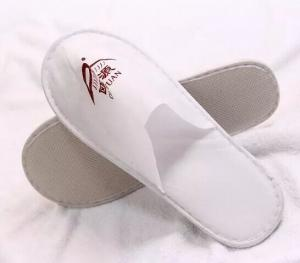China Cheap disposable hotel slippers with Customized logo on sale