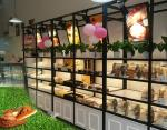 Metal Wooden Food Store Shelving LED Light Bread Display Rack With Three Layer