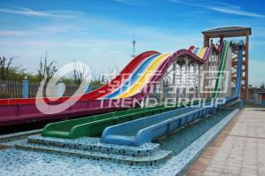 China Cool Huge Fun Rainbow Water Slides With Custom Length 4 Lanes on sale