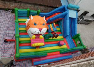 China Amusement Tiger Head childrens Inflatable Bouncy Castle With Slide on sale