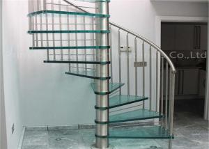 China Modern Stylish Tempered Glass Steps Stainless Steel Frame Spiral Stairs Curved Staircase for Villa on sale