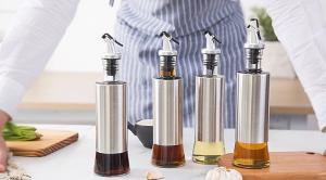 China Metal Casing Glass Oil Bottles With Pourer / Stainless Steel Glass Vinegar Bottle on sale