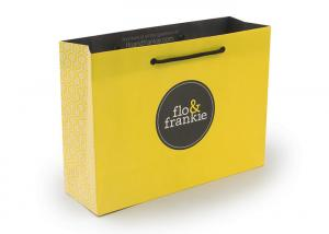 China Yellow Recycled Paper Bags Printed With Logo Rope Handle OEM Service on sale