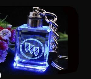 China custom 3D or 2D logo laser engraved blue led crystal light keychain gift on sale