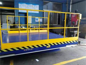 China Stationary Lift Table Hydraulic Dock Lift Equipment Full Toe Guard Forklift Loading on sale
