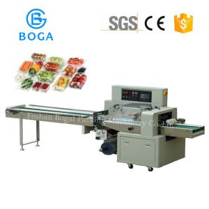 China Dehydrated Fruit Vegetable Packing Machine Auto Double Films Docking Rotary Down Paper on sale