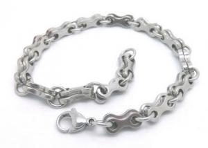 China Adjustable Silver Stainless Steel Bangle Bracelets With Double Bone Charms Link on sale
