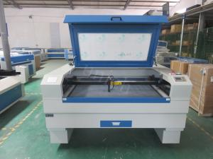 China Double working table 40w 60w 80w 100w co2 laser engraving cutting machine on sale