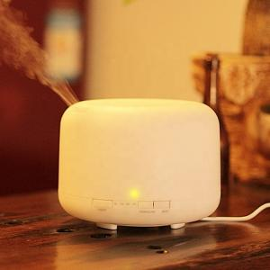 China Circular Column Microcurrent Facial Machine Mini Humidifier Aroma Diffuser on sale