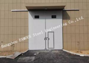 China Sectional Horizontal Sliding Industrial Garage Doors With Access Pedestrian Door For Workshop on sale