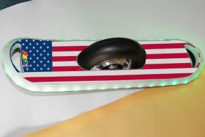 China 10 inch Cool American Flag Style Single Wheel Electric Skateboard Scooter with Bluetooth Speaker and RGB LED lights on sale
