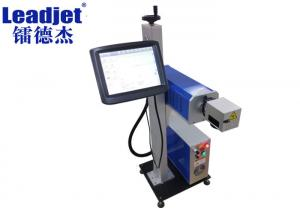 China PET Date Code Printer 0.01mm Line Width CO2 Laser Marking Machine With Touch Screen on sale