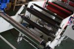 laminating and sheeting machine with web alignment