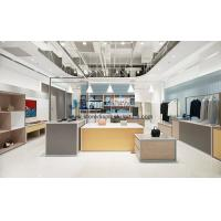 Concise and modern style design for Cloth store interior display furniture by Golden metal rack with Oak wood cabinet