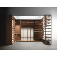Wood cabinets for cloth and shoe racks used by Wardrobe closet and shelves in Walnut wood with metal tubes