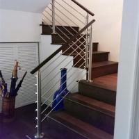 Steel stair rails and banisters with wooden hand rail design