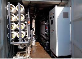 China Wind and Solar energy system powered Containerized Automatic Water Purifier Commercial R.O Plant Booster Pump SS304 on sale