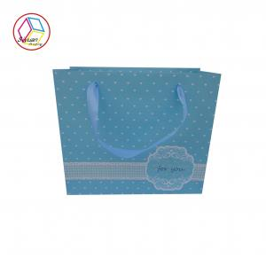 China Personalised Shopping Bags Blue Color Coated Paper Twisted Handle on sale