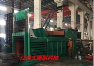 China Horizontal Paper Baler Machine Manual Strapping Conveyor Feeding Material on sale