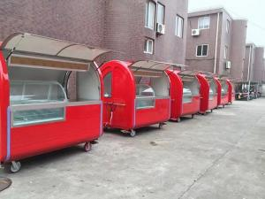 China Round Shape Strong Stainless Steel Mobile Food Cart With Wheels on sale