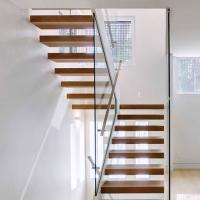 China Low Price Fashionable Small Space wood tread with spigot glass railing Floating Stairs on sale
