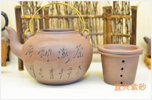 China Handmade Chinese Yixing Zisha Teapot 1000ml With Chinese Words Carving on sale