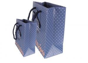 China Floral cartoon advertising cardboard paper handle bag promotional clothing packaging gift shopping bag printing LOGO on sale