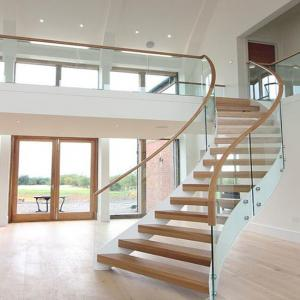 China Solid Oak Wood Curved Staircase Design for Villa on sale