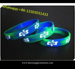 China Custom Made Embossed silicone wristband/bracelet in Any Color and Size on sale