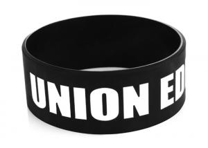 China Black 25mm Width Debossed And Fill In Custom Silicone Rubber Wristbands supplier