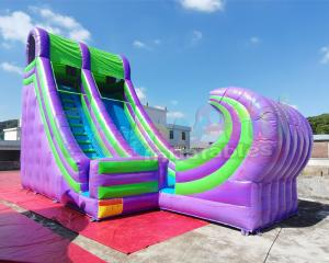 China Ocean Wave Spraying Water Slide Blow Up Inflatable Slide For Sale on sale