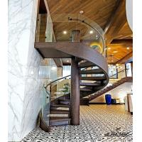 China Custom Modern Staircase Classical Spiral Stairs Wood Grain Steel Structure Glass Railing Wood Step on sale