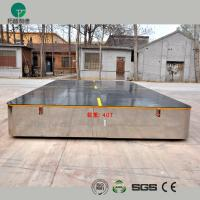 Battery operated steerable motorized trackless transfer car on cement floor