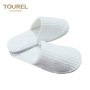 China Strip Coral Fleece Women Indoor Slipper For Guests Disposable Closed Toe Spa Slipper on sale