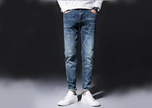 China Woven Tapered Mens Denim Jacket And Jeans Mid Wash Man Pants 100% Cotton on sale