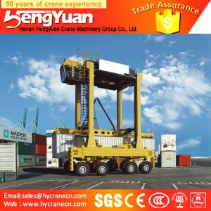 China 40t rubber tyre stacking container low profile Container gantry crane, staddle carrier on sale