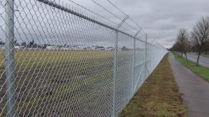 China 4mm PVC Coated Galvanized Chain Link Fence System Airport Fence 3m High on sale