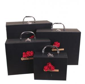 China Color Printing Paper Gift Box Hard Paper Board Big Suitcase Gift Box With Handle on sale