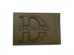 China Lead Free Finish Brown Embossed Leather Patches / Labels For Garment Accessories on sale