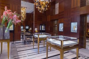 China Jewelry showcase made by square stainless steel counters with LED light strip and Tall cabinets on sale