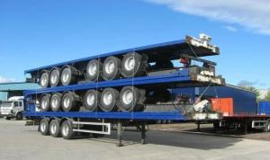 China 13m Extendable air suspension 60t Flat Bed Semi Trailer for transporting 20ft 40ft 45ft on sale