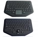 Стоьте одна промышленная загоренная клавиатура с цветом черноты trackball