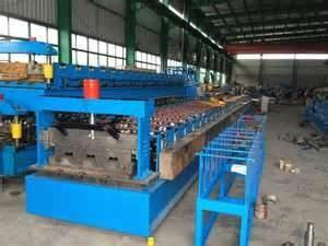 China Double layer cnc 910 colored 300H steel welding rollforming machine with PLC on sale