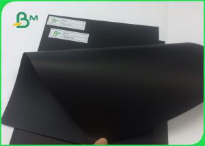 China 100% Wood Pulp Laminated Solid Black Cardboard For Hard Book Cover on sale