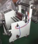 arriba precise la máquina que lamina usada en fábrica material electrónica