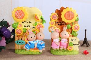 China Sunflower music box brush pot furnishing articles resin process couple little rabbit on sale