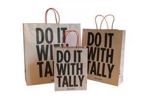 China Brown Kraft  Paper Shopping Bags With Customized Printed Logo / Twisted Handle on sale