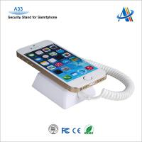 Retail mobile store security devices for smartphone anti-theft display with charging alarm function
