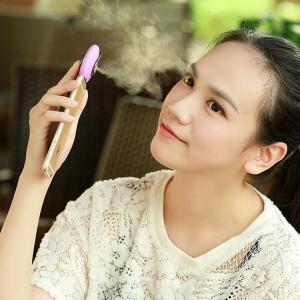 China Mini Mobile Phone Mist Moisturizing Beauty Instrument Portable Water Replenishment Mini Humidifier Facial Water Spray on sale