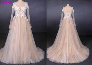 China Long sleeves see through lace with pearls beading tulle a line wedding dress on sale